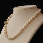 akoya-pearl-necklace-on-a-gold-and-diamond-clasp